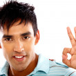 Stock Photo: Casual man doing the ok sign