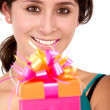 Girl holding a present — Stock Photo