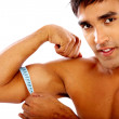 Strong man measuring his biceps — Stock Photo