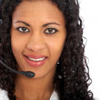 Woman with a headset smiling — Stock Photo