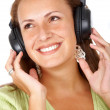 Woman listening to music — Foto Stock