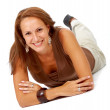 Casual woman smiling on the floor — Stock Photo #7768071