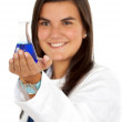 Female doctor using test tubes — Stock Photo