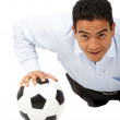 Business man exercising on a football — Stock Photo