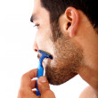 Man shaving his beard - Stock Photo