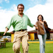 Stock Photo: Happy couple running outdoors
