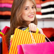Casual woman with shopping bags — Stock Photo #7768337