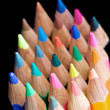 Colour pencils on black — Stockfoto