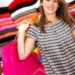 Stock Photo: Casual woman with shopping bags