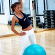 Stock Photo: Gym woman exercising