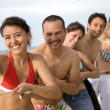 Foto Stock: Happy friends at the beach