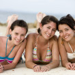 Teenage girls at the beach — Stock fotografie