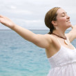 Beach woman enjoying freedom — Stock Photo