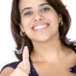 Casual woman thumbs up - Stockfoto