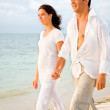 Couple walking at the beach — Stock Photo