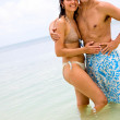 Happy couple at the beach - Stockfoto