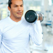 Mdoing free weights — Stock Photo #7768602