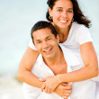 Stock Photo: Happy couple at the beach