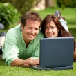 Couple on a laptop - Stock Photo