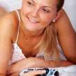 Woman watching tv in bed — Stockfoto #7768670