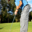 Male golfer in putting green - Foto de Stock