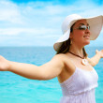 Beach woman enjoying freedom — Stock Photo