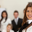 Business woman leading a team - Foto Stock