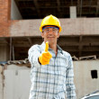 Construction worker with thumbs up - Stock Photo