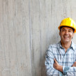 Construction worker smiling - Stock Photo
