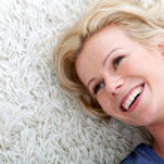 Woman lying on the floor — Stock Photo #7769492