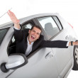 Foto Stock: Happy man on a car