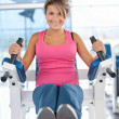 Woman at the gym exercising — Stock Photo #7769586