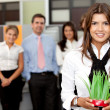 Business woman holding a plant - Stock Photo