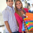 Happy couple shopping — Stock Photo