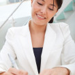 Business woman signing a contract — Stock Photo