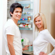 Couple looking inside the fridge — Stock Photo #7769748