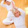 Women practicing yoga - Stock Photo