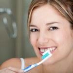 Woman brushing her teeth — Stock Photo #7769786