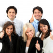 Business team with thumbs up - Stock Photo