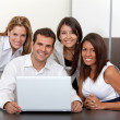 Business group with laptop — Stock Photo