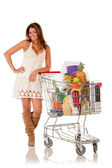 Woman with a shopping cart — Stock Photo