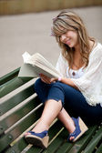 Woman reading outdoors — Stock Photo