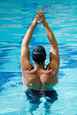 Male swimmer stretching — Stock Photo