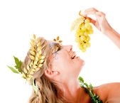 Greek goddess eating grapes — Stock Photo
