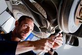 Mechanic in a garage — Stock Photo