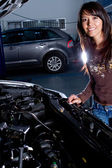 Woman at the mechanic — Stock Photo