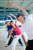 Gym group exercising — Stockfoto