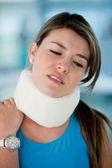 Woman with surgical collar — Stock Photo