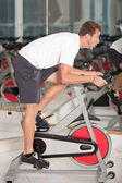 Man doing spinning at the gym — Foto Stock