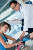 Athletic woman in physiotherapy — Stock Photo